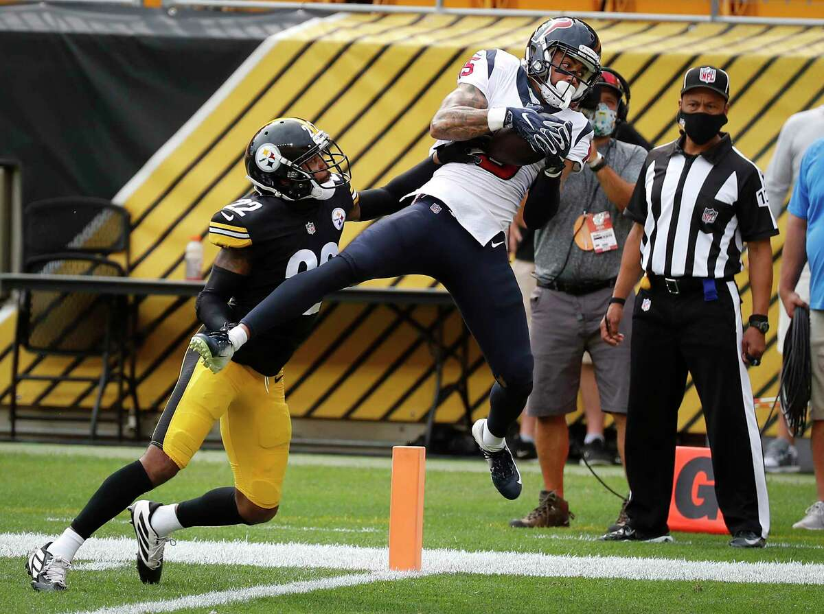 Houston Texans wide receiver Will Fuller (15) beats Pittsburgh Steelers cornerback Steven Nelson (22) for a 14-yard touchdown reception during the first half of an NFL football game at Heinz Field on Sunday, Sept. 27, 2020, in Pittsburgh.