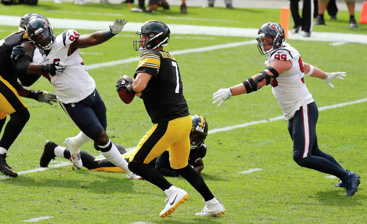 Houston Texans defensive ends Charles Omenihu (94) and J.J. Watt (99) chase Pittsburgh Steelers quarterback Ben Roethlisberger (7) out of the pocket during the first half of an NFL football game at Heinz Field on Sunday, Sept. 27, 2020, in Pittsburgh.