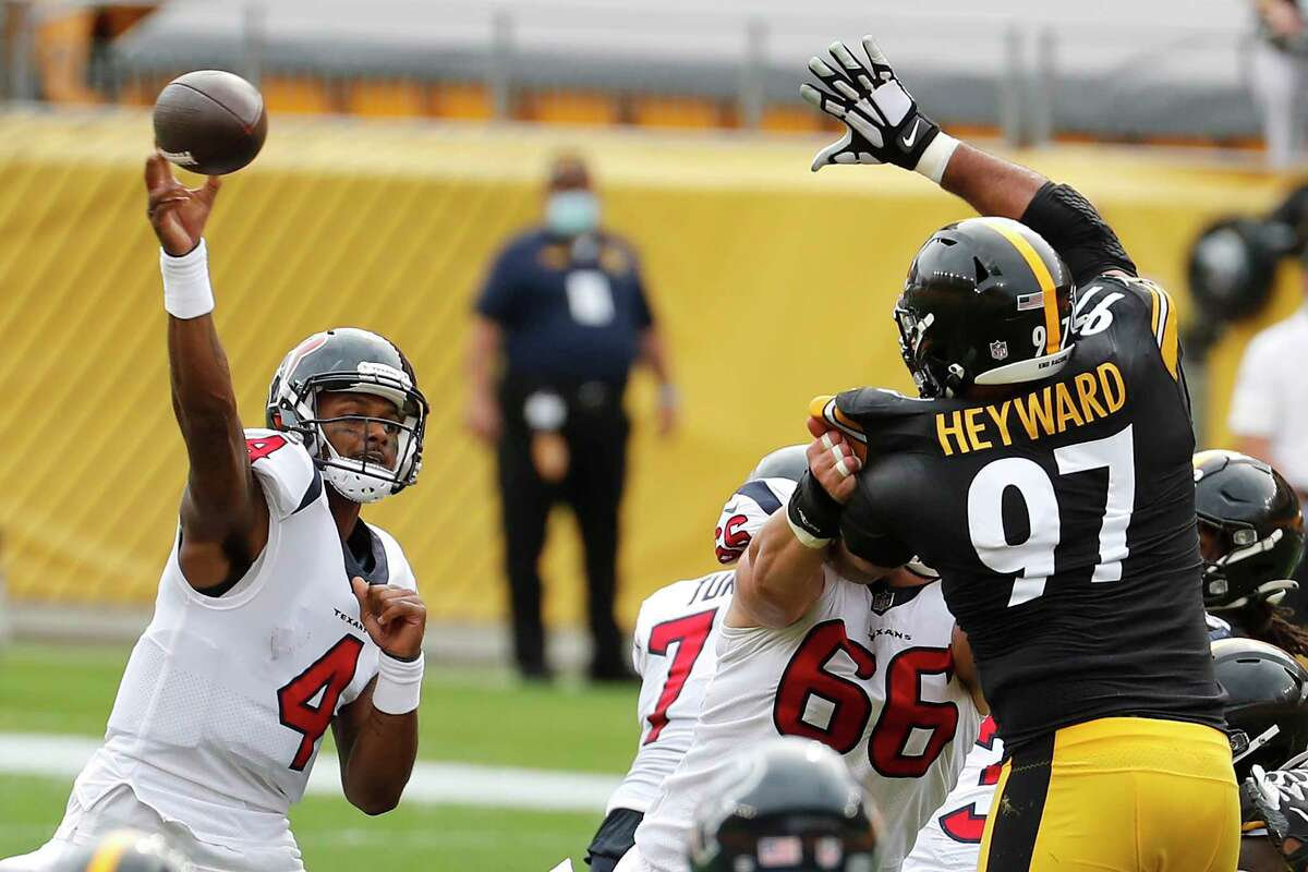 Houston Texans quarterback Deshaun Watson (4) throws over Pittsburgh Steelers defensive end Cameron Heyward (97) during the first half of an NFL football game at Heinz Field on Sunday, Sept. 27, 2020, in Pittsburgh.