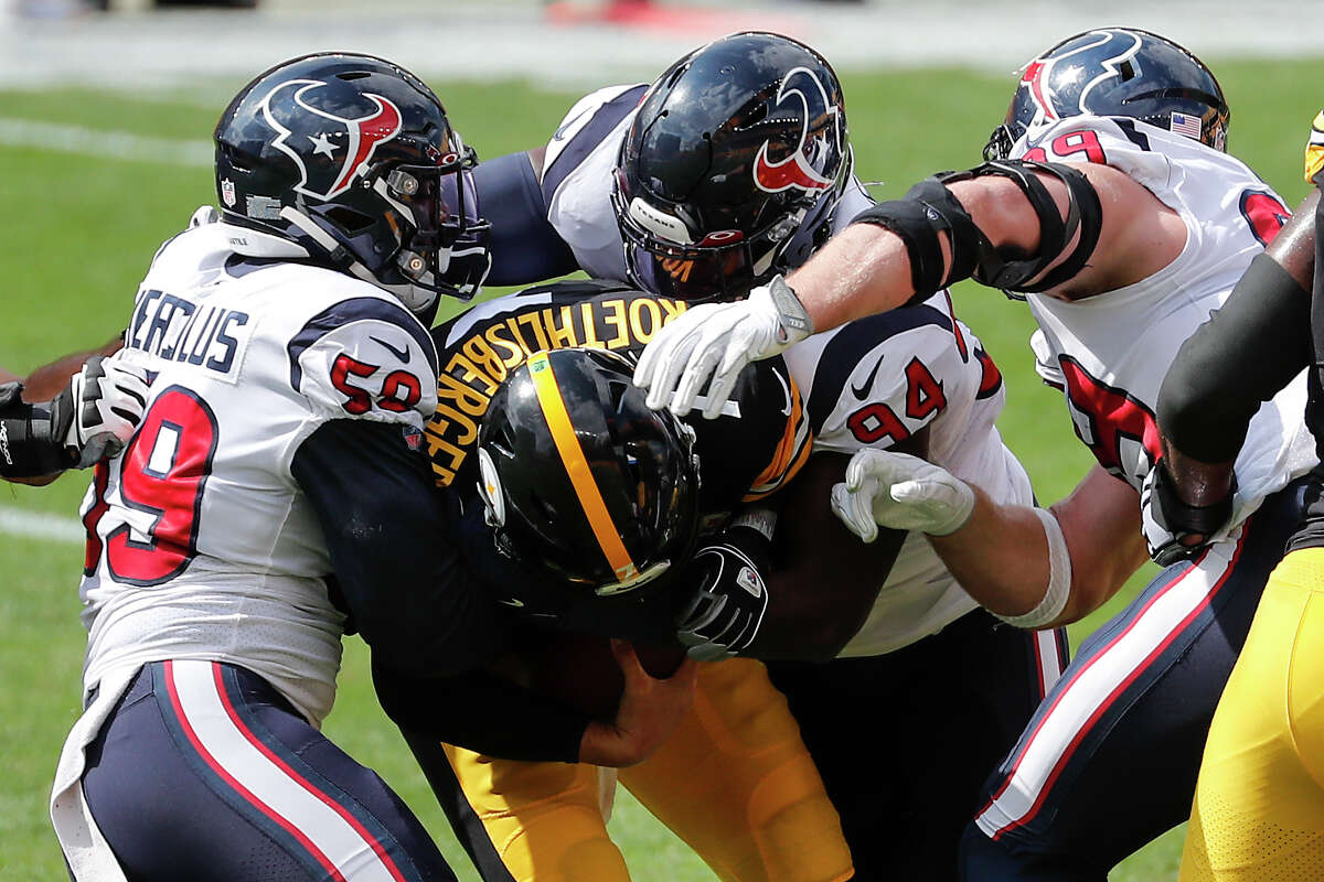 Houston Texans outside linebacker Whitney Mercilus (59), defensive end Charles Omenihu (94)h and defensive end J.J. Watt (99) sack Pittsburgh Steelers quarterback Ben Roethlisberger (7) during the first half of an NFL football game at Heinz Field on Sunday, Sept. 27, 2020, at Heinz Field in Pittsburgh.