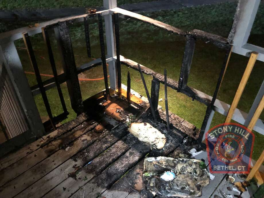 Fire was contained to the rear deck of a house on Putnam Park Road in Bethel Sunday, Sept. 27, after a neighbor's dog began barking, alerting his owner, who called emergency responders. Photo: Stony Hill Volunteer Fire Co. / Contributed Photo / Danbury News Times Contributed