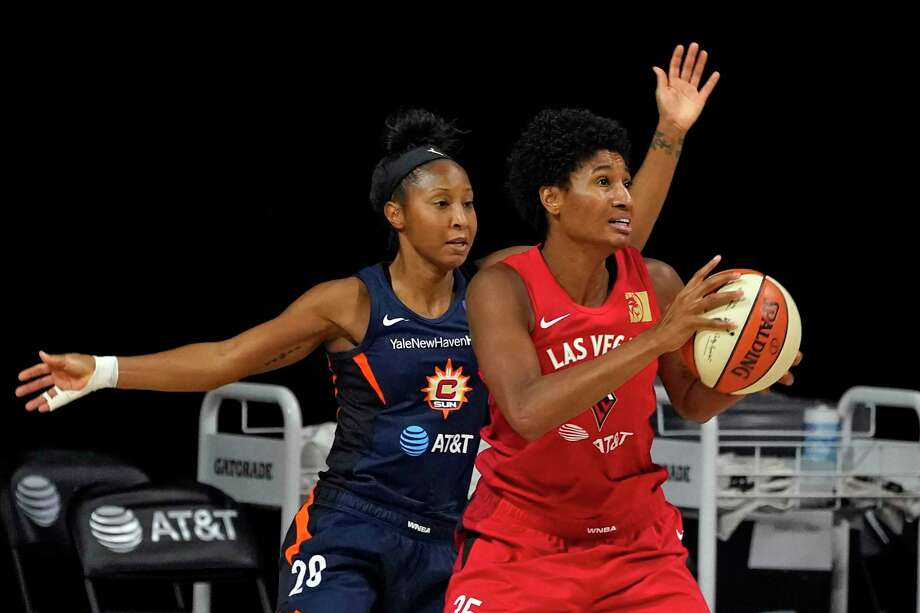 Las Vegas Aces forward Angel McCoughtry, right, is defended by Connecticut Sun guard Briann January during the second half on Sunday. Photo: Chris O'Meara / Associated Press / Copyright 2020 The Associated Press. All rights reserved.