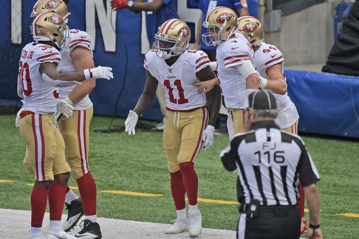 San Francisco 49ers' Brandon Aiyuk, center, celebrates his touchdown during the second half of an NFL football game against the New York Giants, Sunday, Sept. 27, 2020, in East Rutherford, N.J. (AP Photo/Bill Kostroun)