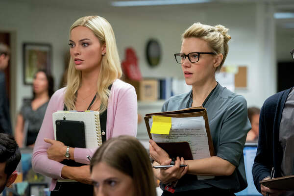 """This image released by Lionsgate shows Margot Robbie, left, and Kate McKinnon in a scene from """"Bombshell."""" On Monday, Jan. 13, Robbie was nominated for an Oscar for best supporting actress for her role in the film. (Hilary B. Gayle/Lionsgate via AP)"""