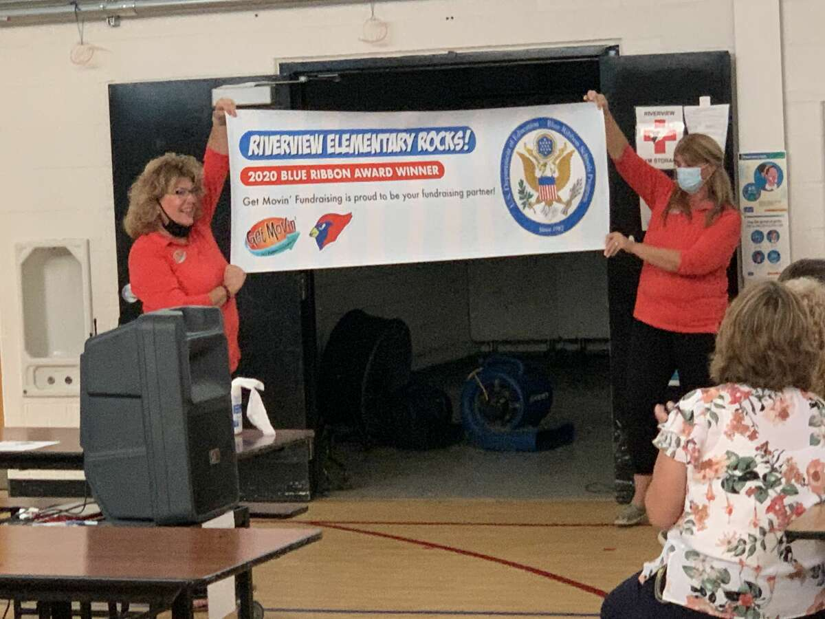 Riverview Elementary staff were shocked after hearing the news their school won the National Blue Ribbon Award. Staff members unveiled a banner recognizing the school's accomplishment.