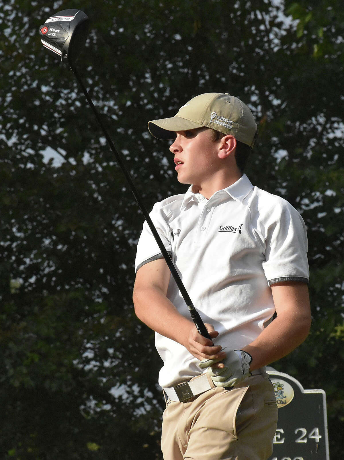 Father McGivney freshman Joey Hyten watches his tee shot during a triangular match against Valmeyer and Metro-East Lutheran.