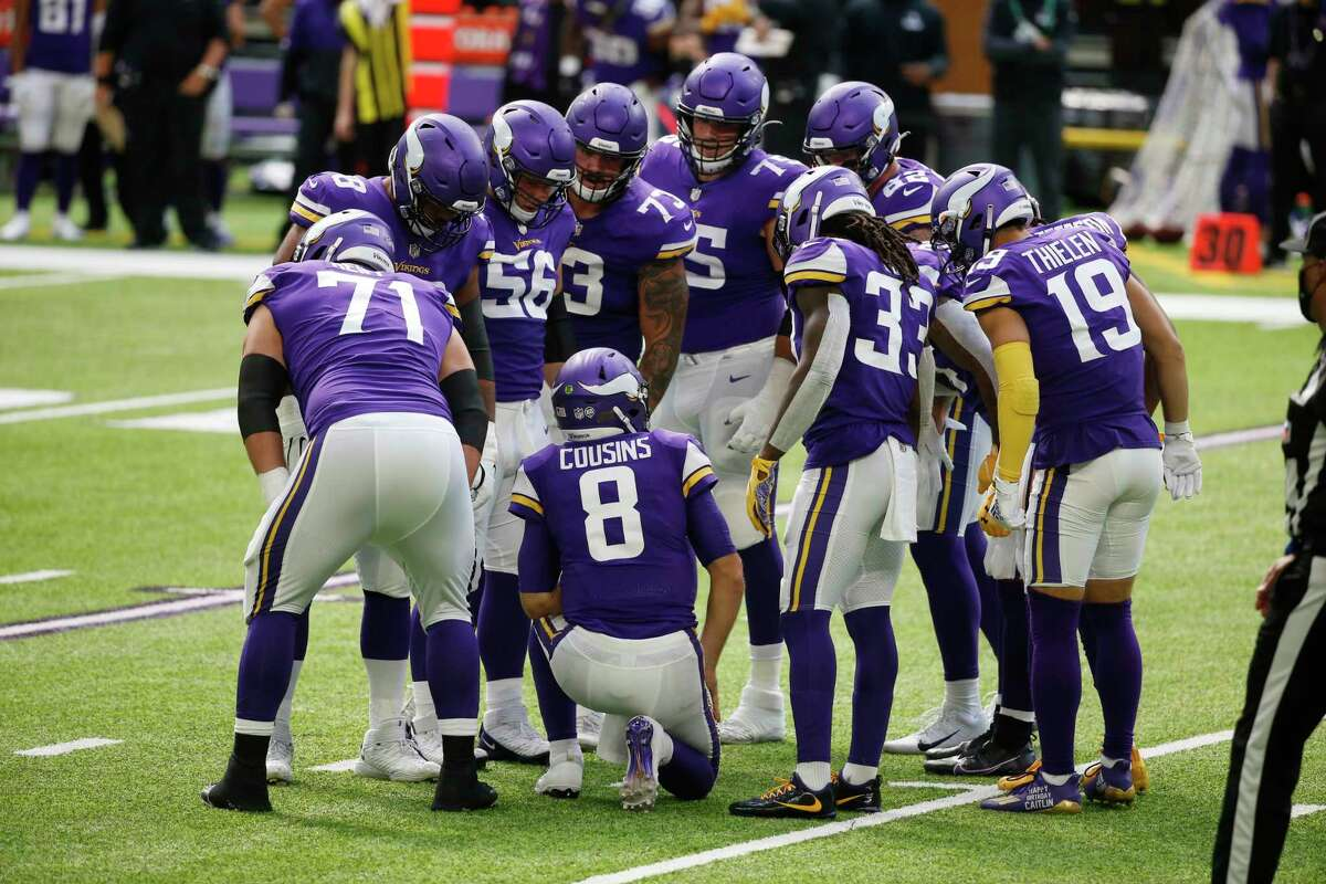 Minnesota Vikings quarterback Kirk Cousins (8) huddles with teammates during the first half of an NFL football game against the Tennessee Titans, Sunday, Sept. 27, 2020, in Minneapolis. (AP Photo/Bruce Kluckhohn)