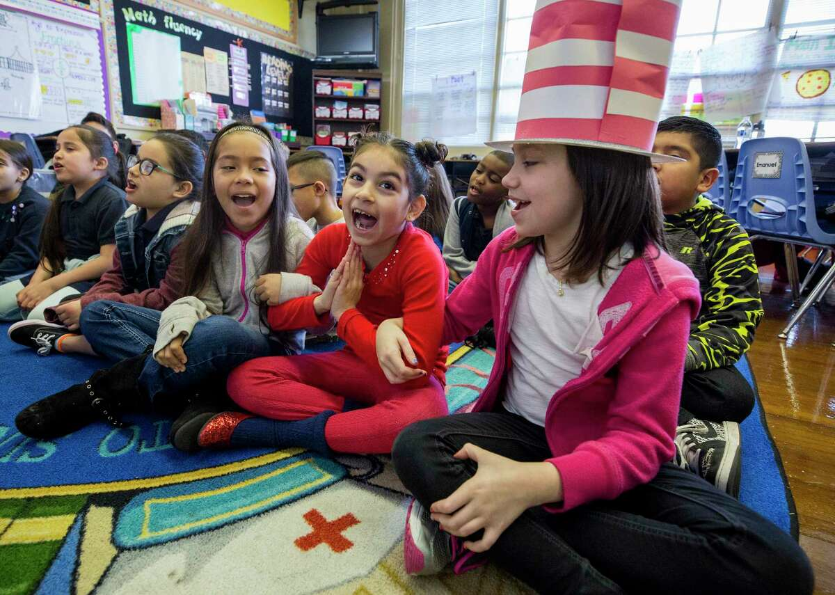Memorial Elementary School third-graders, pictured in 2018 from left to right, Nevaeh Ramirez, Victoria Sanchez, and Taylor Ferrel Neva react as they listen to a book reading during the Read Aloud event at their Houston ISD campus. Memorial Elementary joined three other Houston-area schools this week in receiving National Blue Ribbon Schools awards, which are based on student performance in 2018-19.
