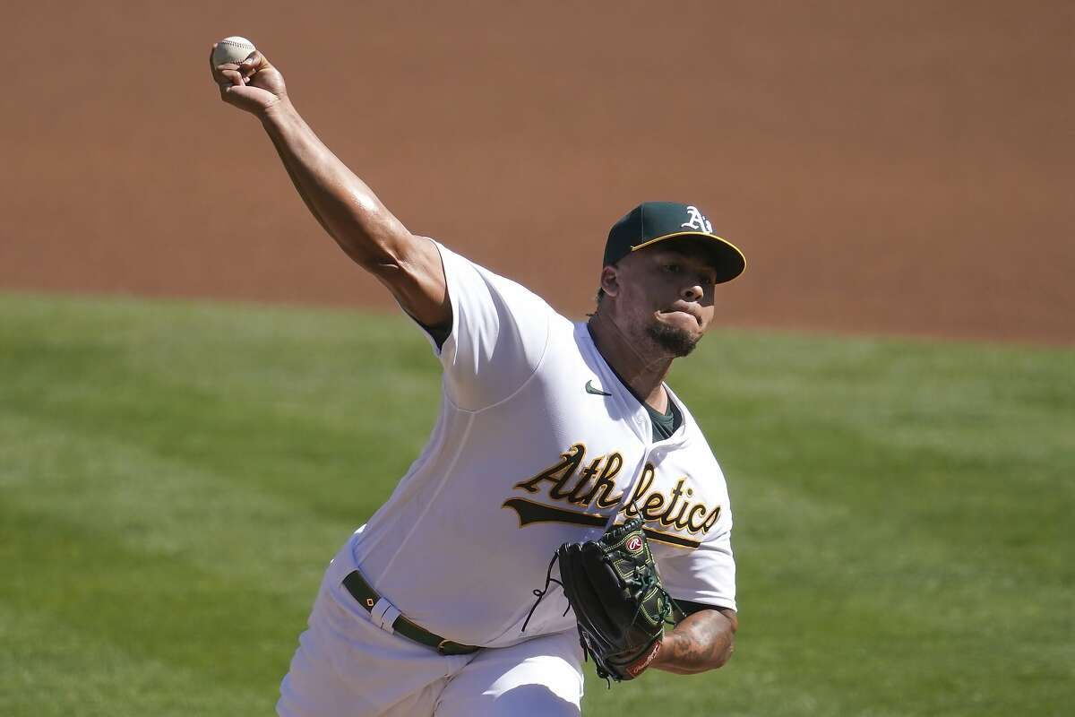 Oakland Athletics' Frankie Montas pitches against the Seattle Mariners during the first inning of a baseball game in Oakland, Calif., Sunday, Sept. 27, 2020. (AP Photo/Jeff Chiu)