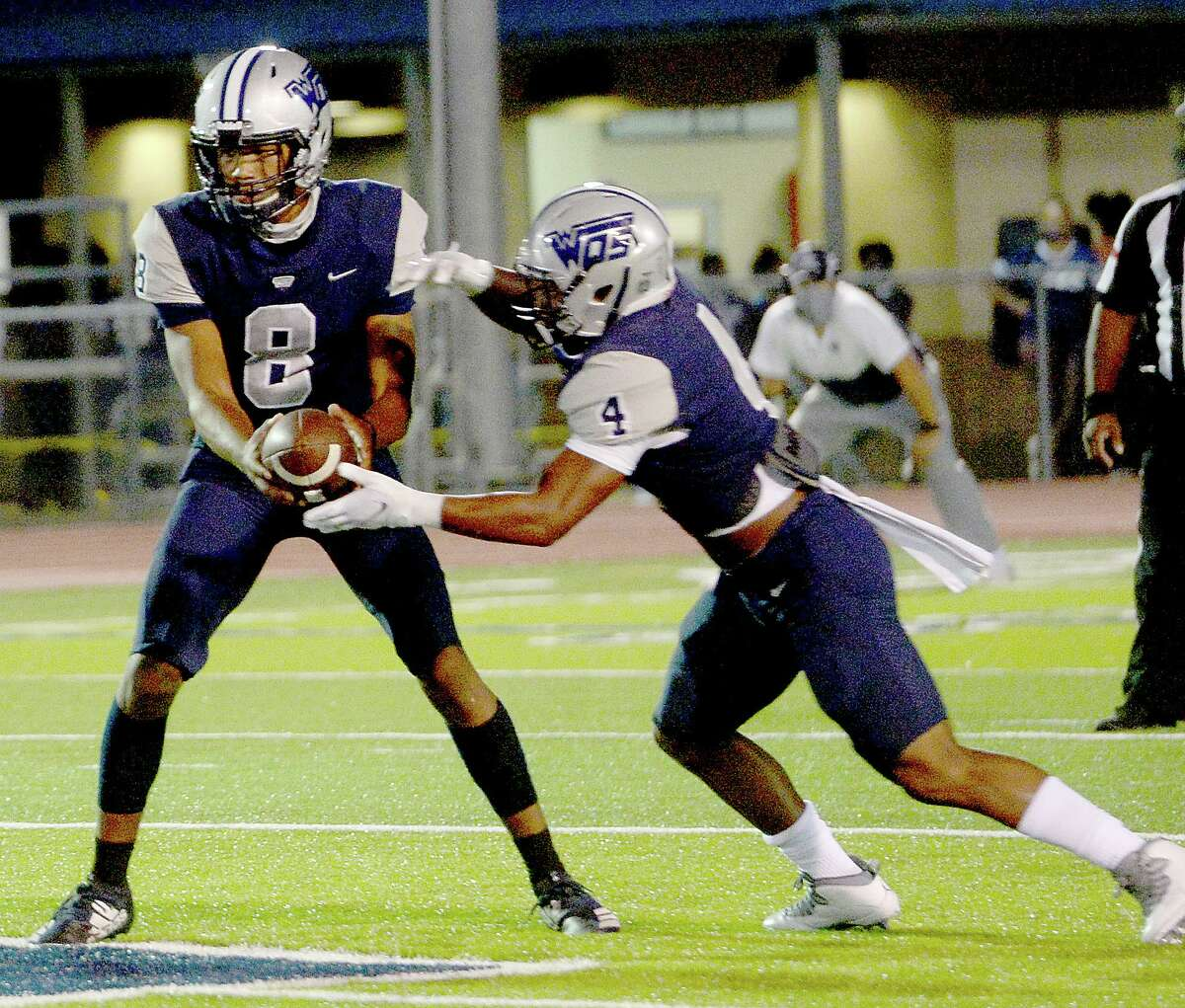 West Orange - Stark's Jerren Terrell hands off the ball to Elijah Gales as they face Newton during their match-up Friday night in West Orange. Photo taken Friday, September 18, 2020 Kim Brent/The Enterprise