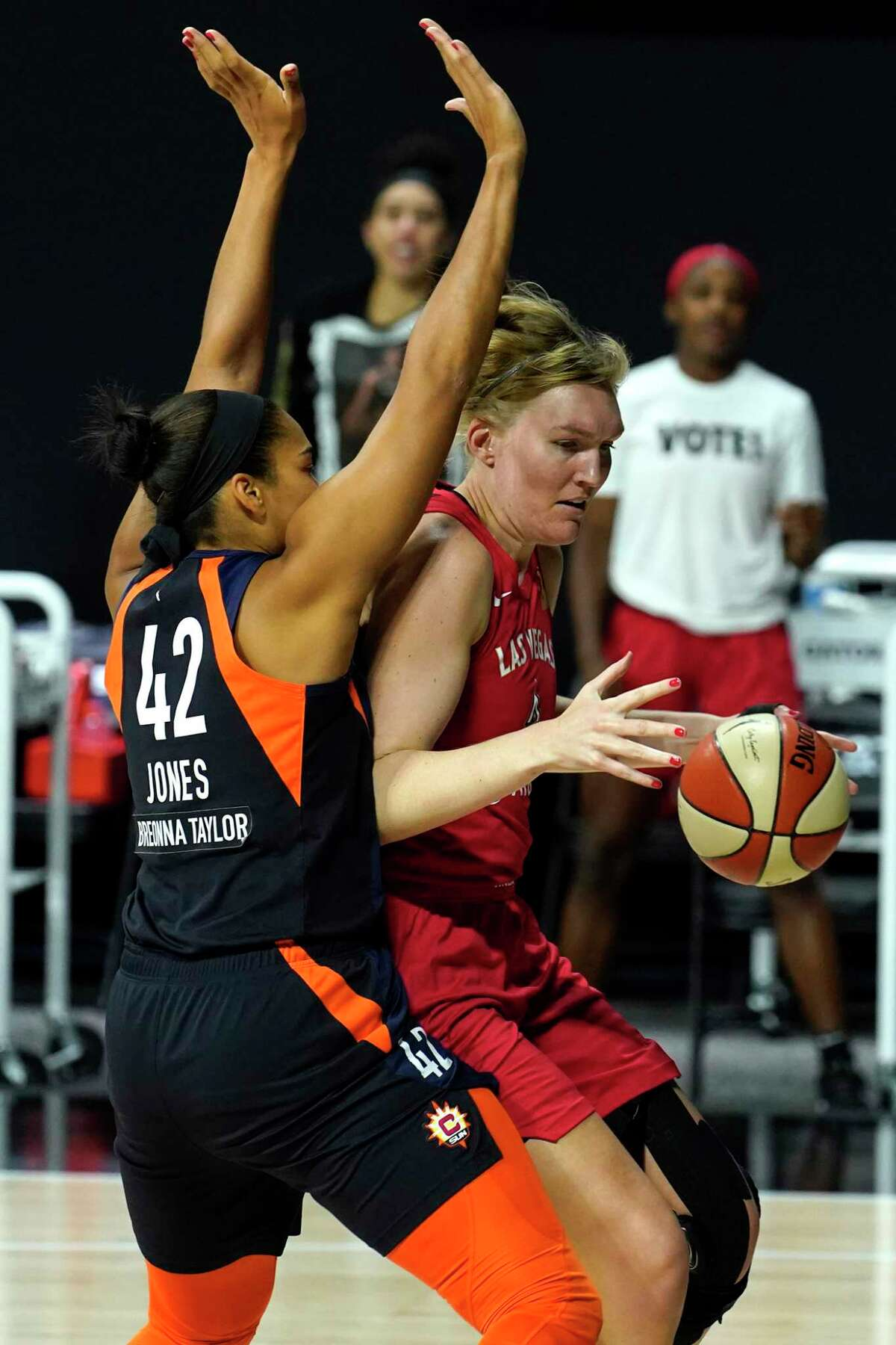 Las Vegas Aces center Carolyn Swords, right, works against Sun center Brionna Jones during the first half on Sunday.