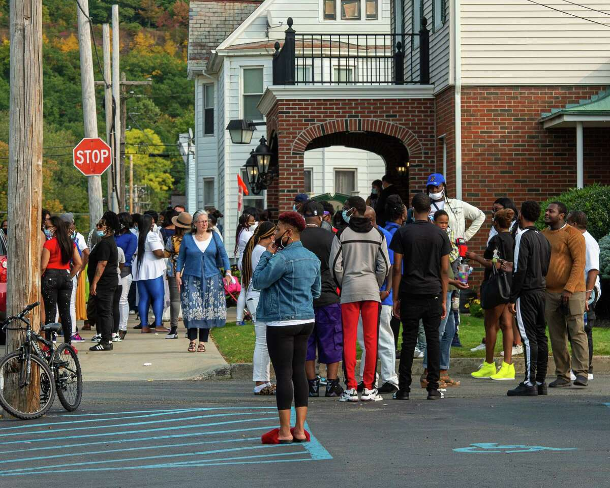 Mourners attend the wake of Ayshawn Davis, the 11-year-old who was killed in a drive-by shooting on Sept. 13, 2020, at the McLoughlin and Mason Funeral Home in Troy, NY on Sunday, Sept. 27, 2020. (Jim Franco/Special to the Times Union.)