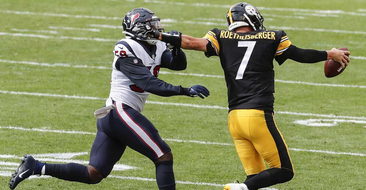 Pittsburgh Steelers quarterback Ben Roethlisberger (7) pushes off the face of Houston Texans outside linebacker Whitney Mercilus (59) as he runs around the end during the third quarter of an NFL football game at Heinz Field on Sunday, Sept. 27, 2020, at Raymond James Stadium in Pittsburgh.