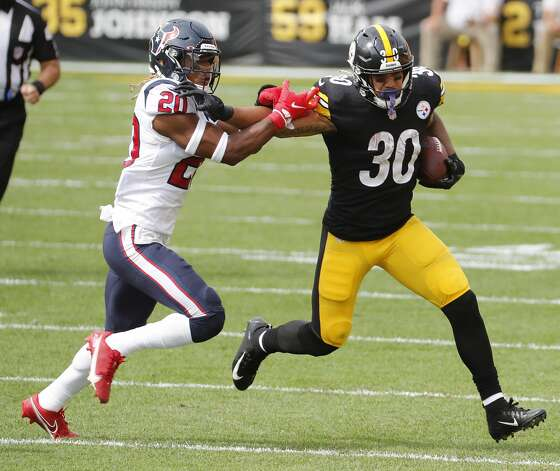 Pittsburgh Steelers running back James Conner (30) runs outside against ]Houston Texans strong safety Justin Reid (20) during the first half of an NFL football game at Heinz Field on Sunday, Sept. 27, 2020, in Pittsburgh. Photo: Brett Coomer/Staff Photographer / © 2020 Houston Chronicle