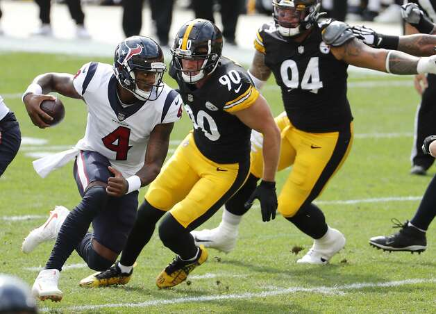 Houston Texans quarterback Deshaun Watson (4) is forced to run out of the pocket by Pittsburgh Steelers outside linebacker T.J. Watt (90) during the first half of an NFL football game at Heinz Field on Sunday, Sept. 27, 2020, in Pittsburgh. Photo: Brett Coomer/Staff Photographer / © 2020 Houston Chronicle