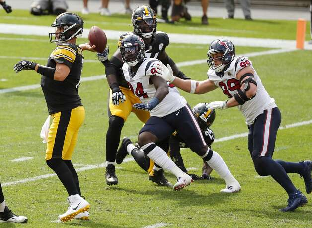 Houston Texans defensive ends Charles Omenihu (94) and J.J. Watt (99) chase Pittsburgh Steelers quarterback Ben Roethlisberger (7) out of the pocket during the first half of an NFL football game at Heinz Field on Sunday, Sept. 27, 2020, in Pittsburgh. Photo: Brett Coomer/Staff Photographer / © 2020 Houston Chronicle