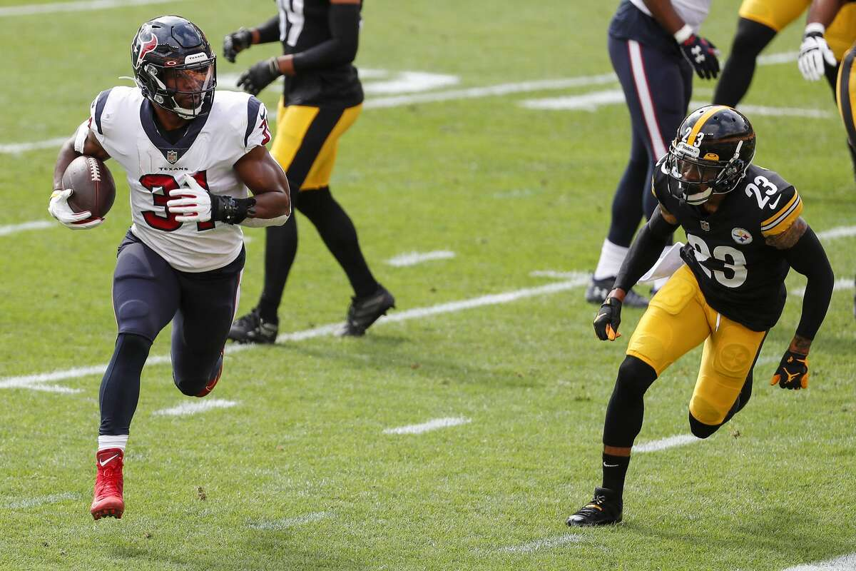 Houston Texans running back David Johnson (31) runs past Pittsburgh Steelers cornerback Joe Haden (23) for a 2-yard touchdown run during the first half of an NFL football game at Heinz Field on Sunday, Sept. 27, 2020, at Raymond James Stadium in Pittsburgh.