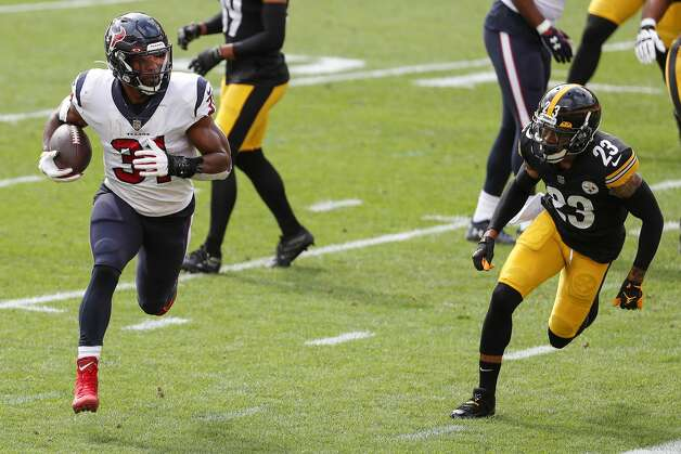 Houston Texans running back David Johnson (31) runs past Pittsburgh Steelers cornerback Joe Haden (23) for a 2-yard touchdown run during the first half of an NFL football game at Heinz Field on Sunday, Sept. 27, 2020, in Pittsburgh. Photo: Brett Coomer/Staff Photographer / © 2020 Houston Chronicle