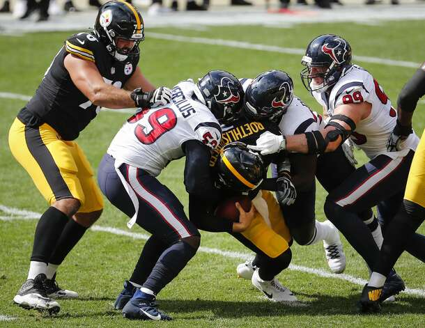 Houston Texans outside linebacker Whitney Mercilus (59), defensive end Charles Omenihu (94)h and defensive end J.J. Watt (99) sack Pittsburgh Steelers quarterback Ben Roethlisberger (7) during the first half of an NFL football game at Heinz Field on Sunday, Sept. 27, 2020, in Pittsburgh. Photo: Brett Coomer/Staff Photographer / © 2020 Houston Chronicle