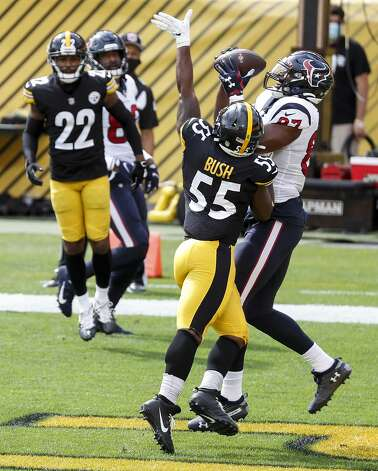 Pittsburgh Steelers inside linebacker Devin Bush (55) breaks up a pass in the end zone intended for Houston Texans tight end Darren Fells (87) during the first half of an NFL football game at Heinz Field on Sunday, Sept. 27, 2020, in Pittsburgh. Photo: Brett Coomer/Staff Photographer / © 2020 Houston Chronicle