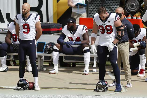 Houston Texans defensive end Charles Omenihu (94) sits on the bench behind punter Bryan Anger (9) and defensive end J.J. Watt (99) during the national anthem before an NFL football game against the Pittsburgh Steelers at Heinz Field on Sunday, Sept. 27, 2020, in Pittsburgh. Photo: Brett Coomer/Staff Photographer / © 2020 Houston Chronicle