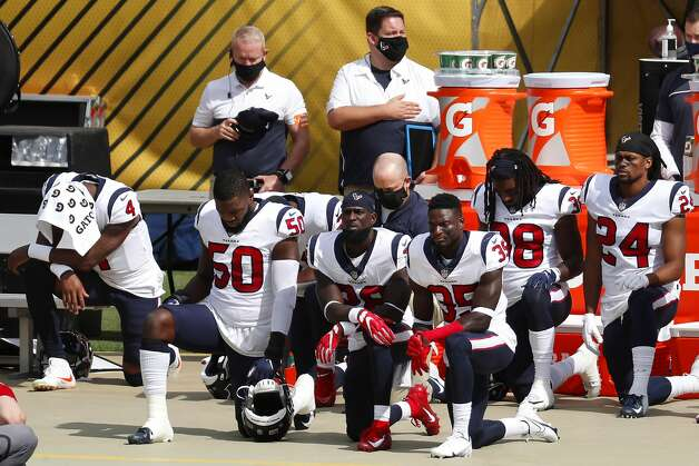 Houston Texans head coach Bill O'Brien, center, takes a knee with a handful of Texans players during the national anthem before an NFL football game against the Pittsburgh Steelers at Heinz Field on Sunday, Sept. 27, 2020, in Pittsburgh. Photo: Brett Coomer/Staff Photographer / © 2020 Houston Chronicle
