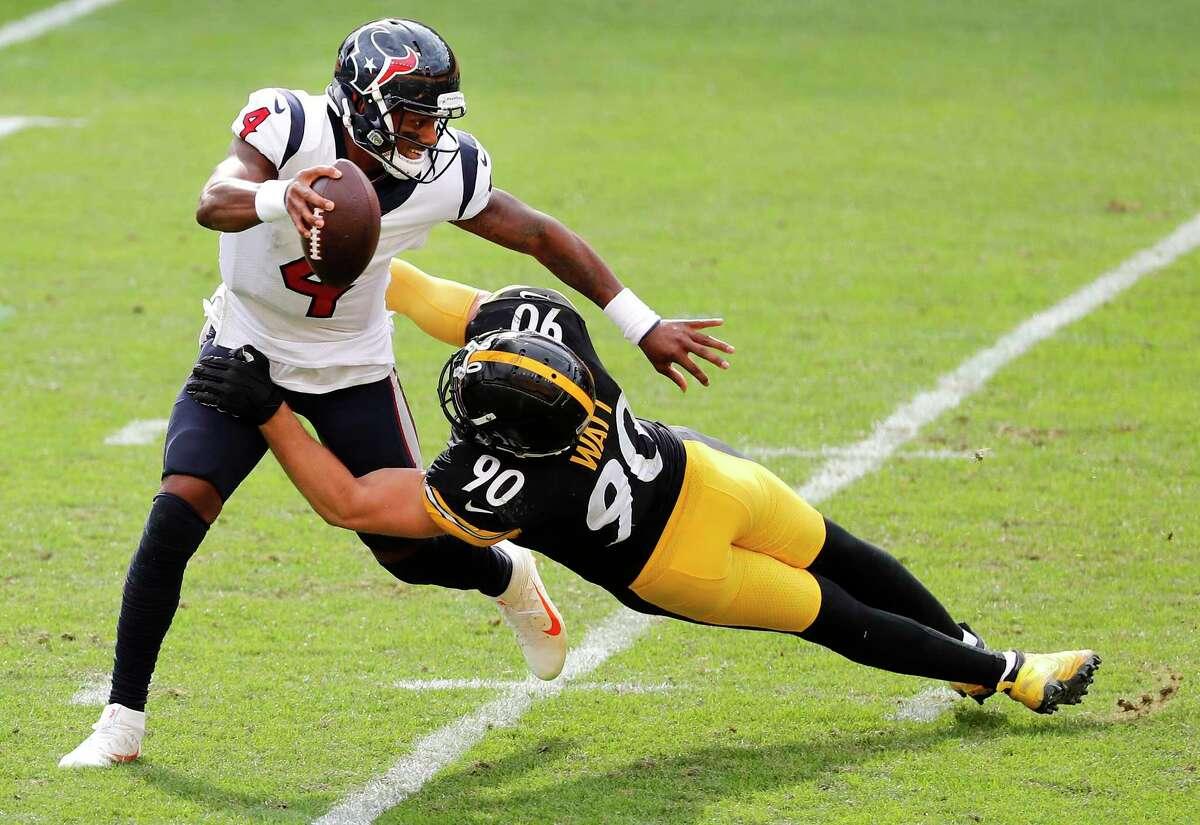 Steelers linebacker T.J. Watt (90) corrals Texans quarterback Deshaun Watson for one Pittsburgh's five sacks in its 28-21 victory at Heinz Field on Sunday.
