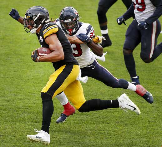 Pittsburgh Steelers wide receiver Chase Claypool (11) runs pastHouston Texans free safety Eric Murray (23) for a first down reception during the fourth quarter of an NFL football game at Heinz Field on Sunday, Sept. 27, 2020, in Pittsburgh. Photo: Brett Coomer/Staff Photographer / © 2020 Houston Chronicle