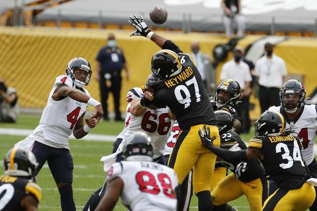 Houston Texans quarterback Deshaun Watson (4) throws over Pittsburgh Steelers defensive end Cameron Heyward (97) during the first half of an NFL football game at Heinz Field on Sunday, Sept. 27, 2020, in Pittsburgh. Photo: Brett Coomer/Staff Photographer / © 2020 Houston Chronicle