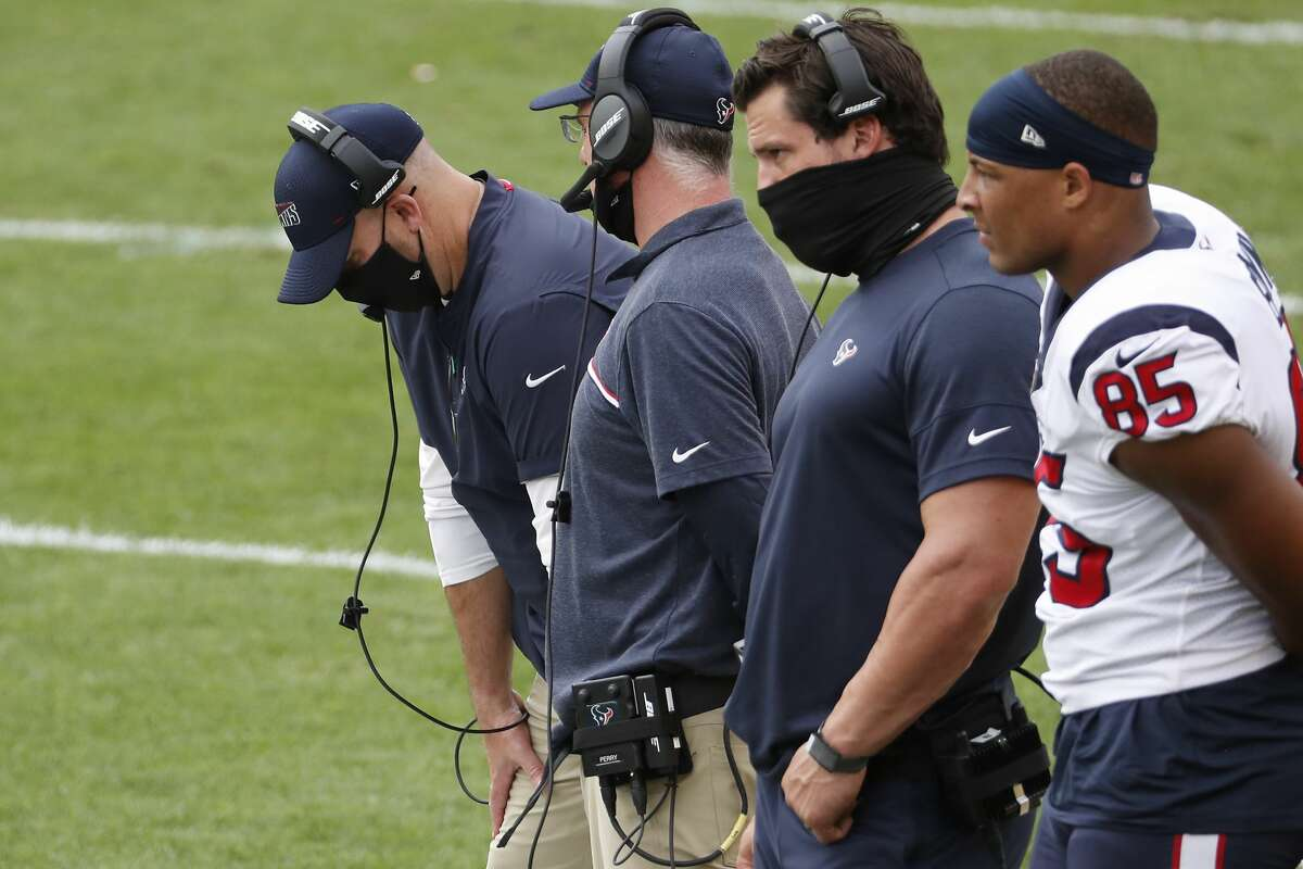 Houston Texans head coach Bill O'Brien, left, looks down as he stands on the sidelines late in the fourth quarter of an NFL football game against the Pittsburgh Steelers at Heinz Field on Sunday, Sept. 27, 2020, at Raymond James Stadium in Pittsburgh.