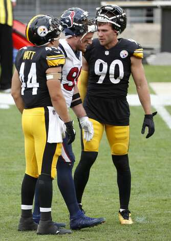 Pittsburgh Steelers fullback Derek Watt (44), Houston Texans defensive end J.J. Watt (99) and Steelers outside linebacker T.J. Watt (90) stand together following an NFL football game at Heinz Field on Sunday, Sept. 27, 2020, in Pittsburgh. Photo: Brett Coomer/Staff Photographer / © 2020 Houston Chronicle