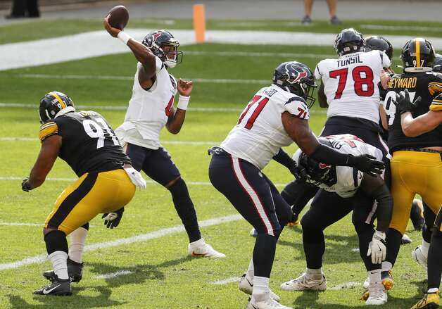 Houston Texans quarterback Deshaun Watson (4) throws from deep in Texans territory as the is rushed by Pittsburgh Steelers defensive end Stephon Tuitt (91) during the fourth quarter of an NFL football game at Heinz Field on Sunday, Sept. 27, 2020, in Pittsburgh. Photo: Brett Coomer/Staff Photographer / © 2020 Houston Chronicle
