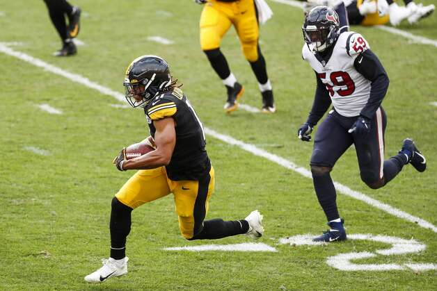 Pittsburgh Steelers wide receiver Chase Claypool (11) beats Houston Texans outside linebacker Whitney Mercilus (59) for a first down reception during the fourth quarter of an NFL football game at Heinz Field on Sunday, Sept. 27, 2020, in Pittsburgh. Photo: Brett Coomer/Staff Photographer / © 2020 Houston Chronicle