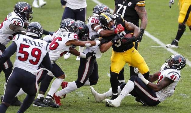 Pittsburgh Steelers running back James Conner (30) is stopped by Houston Texans strong safety Justin Reid (20) and inside linebacker Zach Cunningham (41) during the fourth quarter of an NFL football game at Heinz Field on Sunday, Sept. 27, 2020, in Pittsburgh. Photo: Brett Coomer/Staff Photographer / © 2020 Houston Chronicle