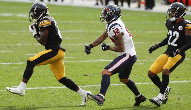 Pittsburgh Steelers cornerback Mike Hilton (28) leaps in front of Houston Texans wide receiver Kenny Stills (12) to intercept a Deshaun Watson pass during the fourth quarter of an NFL football game at Heinz Field on Sunday, Sept. 27, 2020, in Pittsburgh. Photo: Brett Coomer/Staff Photographer / © 2020 Houston Chronicle