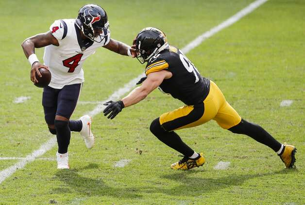 Houston Texans quarterback Deshaun Watson (4) tries in vain to escape the onrushing Pittsburgh Steelers outside linebacker T.J. Watt (90) during the fourth quarter of an NFL football game at Heinz Field on Sunday, Sept. 27, 2020, in Pittsburgh. Watt sacked Watson on the play. Photo: Brett Coomer/Staff Photographer / © 2020 Houston Chronicle