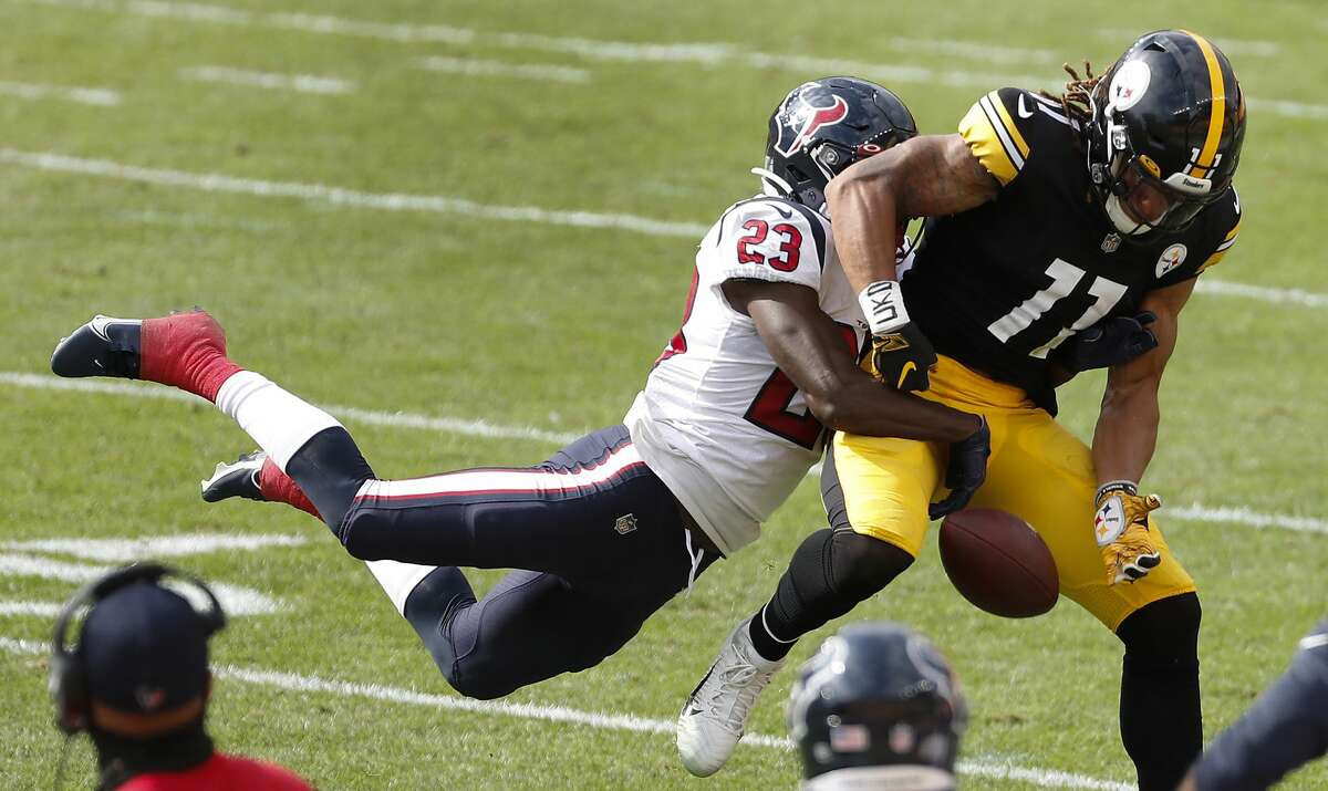 Houston Texans free safety Eric Murray (23) breaks up a pass intended for Pittsburgh Steelers wide receiver Chase Claypool (11) during the third quarter of an NFL football game at Heinz Field on Sunday, Sept. 27, 2020.