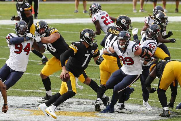 Pittsburgh Steelers quarterback Ben Roethlisberger (7) is chased from the pocket by Houston Texans defensive ends Charles Omenihu (94) and J.J. Watt (99) during the third quarter of an NFL football game at Heinz Field on Sunday, Sept. 27, 2020, in Pittsburgh. Photo: Brett Coomer/Staff Photographer / © 2020 Houston Chronicle