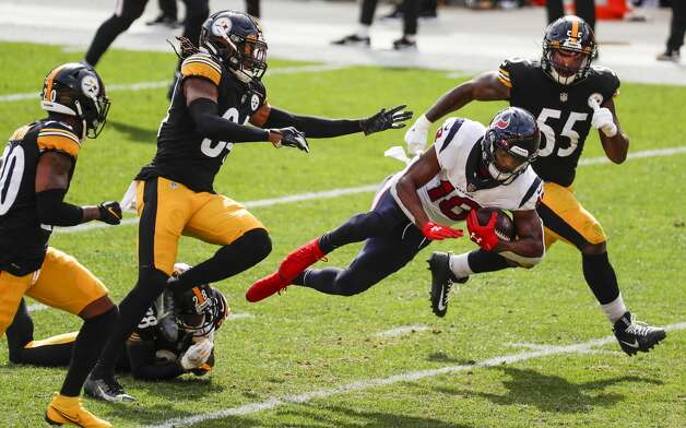 Houston Texans wide receiver Randall Cobb (18) leaps for extra yardage past Pittsburgh Steelers strong safety Terrell Edmunds (34), cornerback Mike Hilton (28) and linebacker Devin Bush (55) after making a first down reception during the fourth quarter of an NFL football game at Heinz Field on Sunday, Sept. 27, 2020, in Pittsburgh. Photo: Brett Coomer/Staff Photographer / © 2020 Houston Chronicle