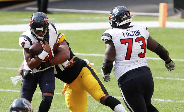 Houston Texans quarterback Deshaun Watson (4) is sacked by Pittsburgh Steelers defensive end Stephon Tuitt (91) during the third quarter of an NFL football game at Heinz Field on Sunday, Sept. 27, 2020, in Pittsburgh. Photo: Brett Coomer/Staff Photographer / © 2020 Houston Chronicle