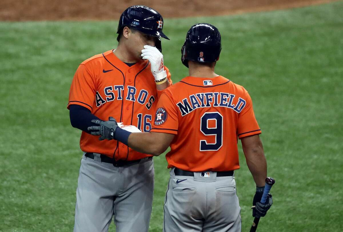 ARLINGTON, TEXAS - SEPTEMBER 27: Aledmys Diaz #16 celebrates a home run with Jack Mayfield #9 of the Houston Astros against the Texas Rangers in the eighth inning at Globe Life Field on September 27, 2020 in Arlington, Texas. (Photo by Ronald Martinez/Getty Images)