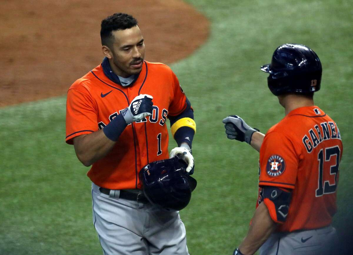 PHOTOS: A look at how the Astros did each game of the regular season Carlos Correa #1 of the Houston Astros celebrates a home run with Dustin Garneau #13 against the Texas Rangers in the fourth inning at Globe Life Field on September 27, 2020 in Arlington, Texas. (Photo by Ronald Martinez/Getty Images)