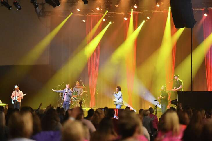 Music and singing start the Woman of Joy conference at the Henry B. Gonzales Convention Center Saturday morning. The event was the first at the convention center since the pandemic started.