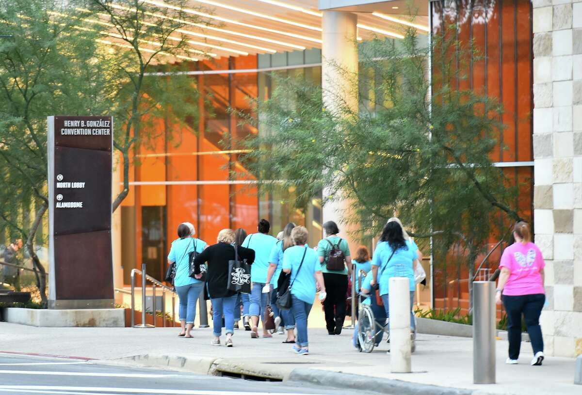 People arrive for the Woman of Joy conference at the Henry B. Gonzales Convention Center Saturday morning. The event was the first at the convention center since the pandemic started.