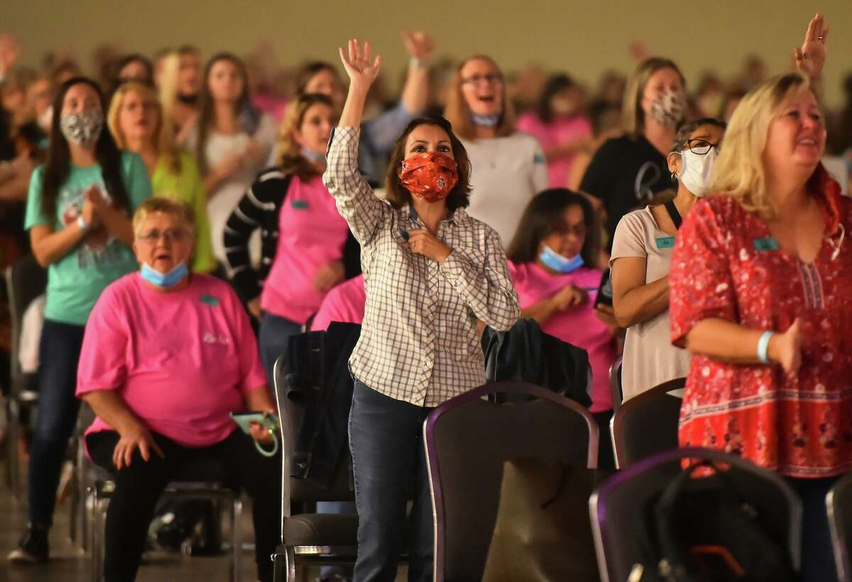 Attendees sing during the Woman of Joy conference at the Henry B. Gonzales Convention Center in September. The event was the first at the Convention Center since the pandemic started.