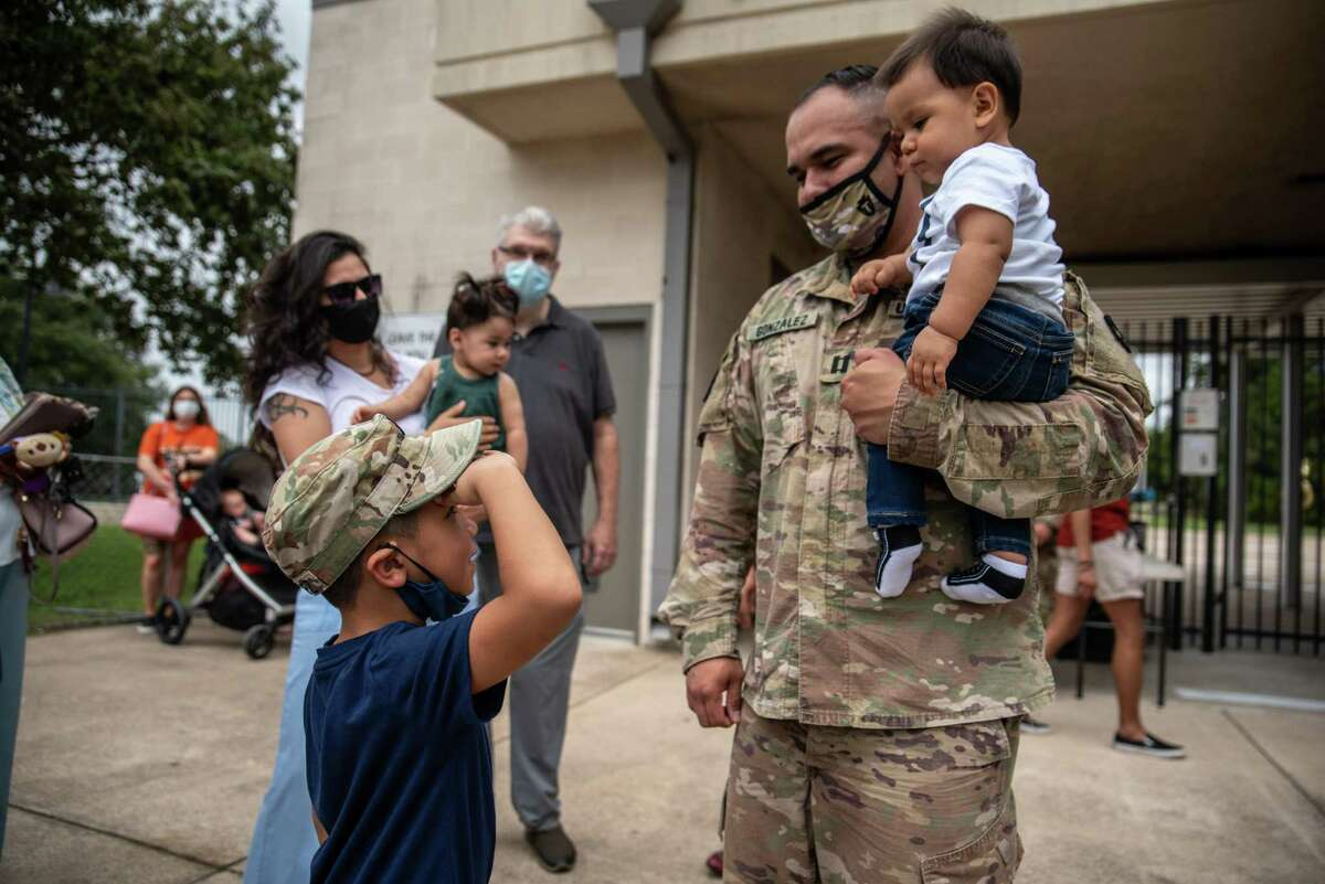 Brandon Gonzalez, age 6, salutes his father, Capt. Andrew Gonzalez, on Sunday, Sept. 27, 2020, at Kelly Reeves Stadium in Austin. Members of the Texas Army National Guard said goodbye to family and friends before leaving for a nine-month deployment to the Middle East.