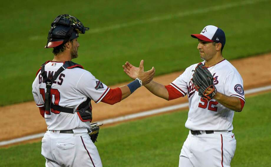 Washington Nationals catcher Yan Gomes greets reliever Paolo Espino after their final game of the shortened 2020 season at Nationals Park on Sunday, Sept. 27, 2020. Photo: Washington Post Photo By Jonathan Newton / The Washington Post