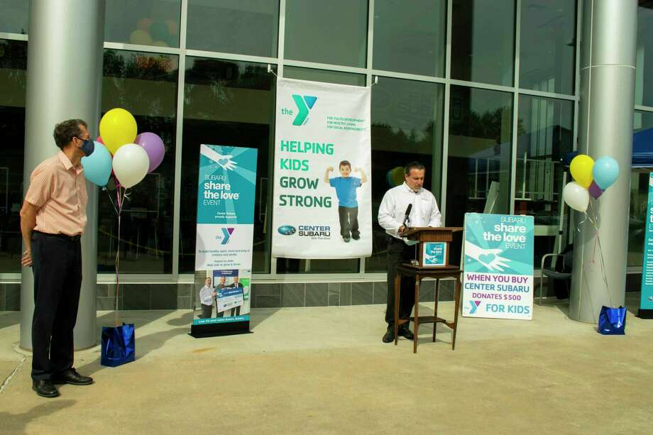 Andy Maiolo, general manager of Center Subaru in Torrington, right, speaks during a donation presentation Sept. 24 to the Northwest CT YMCA Thursday. YMCA CEO Greg Brisco is on the left. Photo: Center Subaru / Contributed Photo /