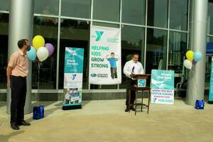 Andy Maiolo, general manager of Center Subaru in Torrington, right, speaks during a donation presentation Sept. 24 to the Northwest CT YMCA Thursday. YMCA CEO Greg Brisco is on the left.