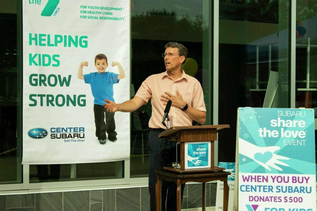 Northwest CT YMCA CEO Greg Brisco speaks during a donation presentation at Center Subaru Thursday.